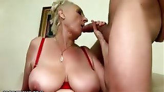 This young stud gives granny the big cock fuck session she asked Santa for, this guy really puts a pounding on this old skank...