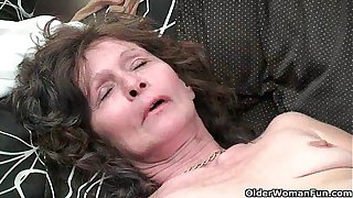 Saggy granny in stockings masturbates hairy pussy